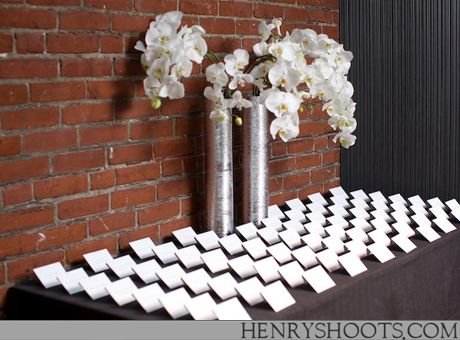 sleek and chic escort cards featuring phalaenopsis orchids at Le Meridien Philadelphia