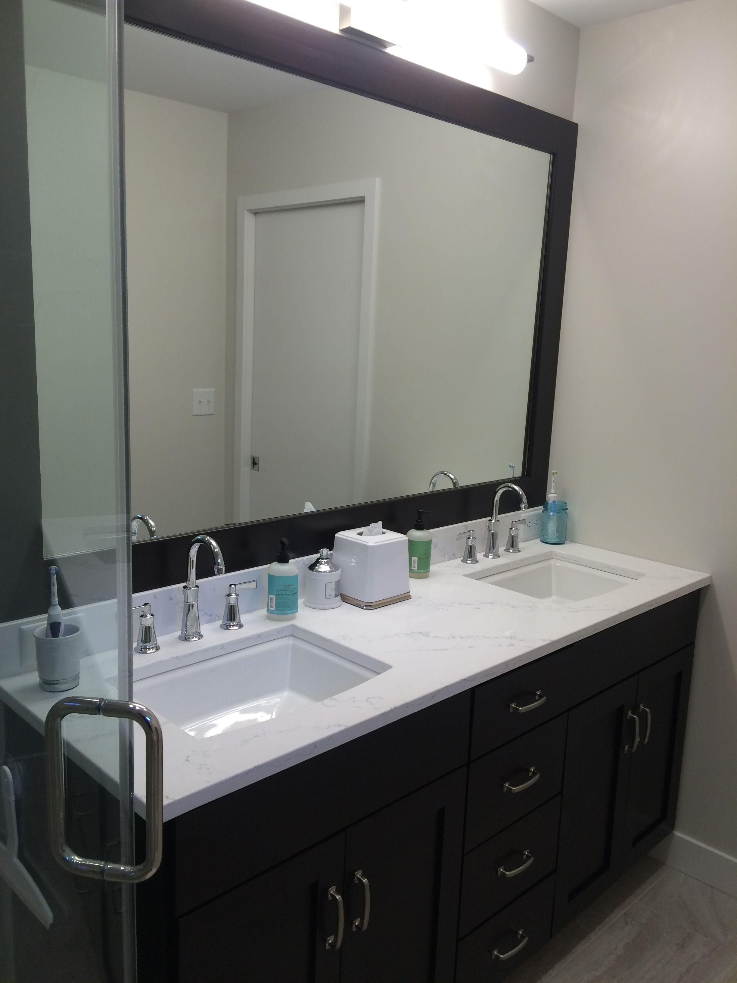 Custom vanity with espresso stain with quartz countertop