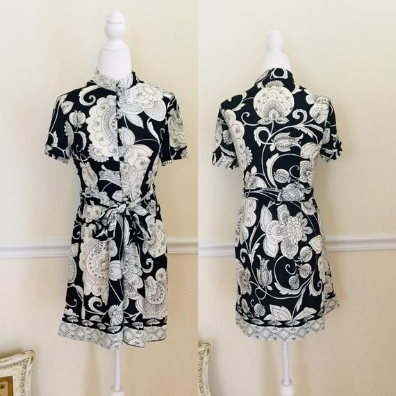 """- Vintage Questo Black & White Floral Dress- Item is preowned & vintage circa 1960s- Item is in great used condition, mild discoloration on buttons- Please see all photos as they are part of the description - Designer: Questo- Fabric Feels like a poly blend, has a little stretch to it- Approximate Measurements Chest 31""""Waist 28""""Length 32.5""""Belt is about 72"""" long- This item will require signature confirmation upon delivery- I gladly refund shipping overages greater than $2** For more vintage clot"""