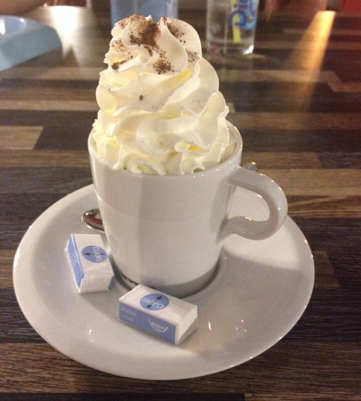Coffee with mile high whipped cream and chocolates