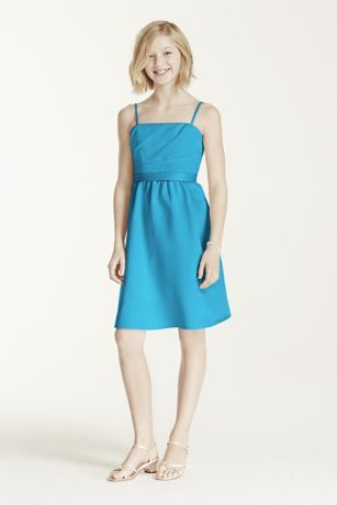 This satinshort dressincludes a full skirt and tie back.  Designed to coordinate with our bridesmaids gowns, the spaghetti straps keep this dress simple, yet elegant.  This style features an adjustable fit for added flexibility and comfort with fewer alterations.  Full lining. Back zip. Dry clean only.