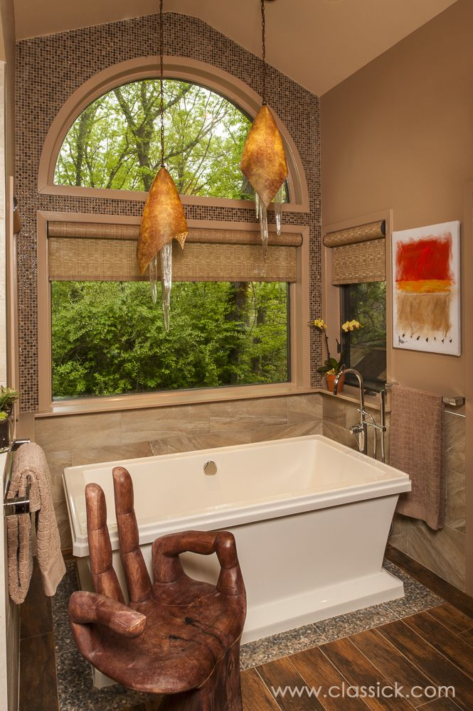 Free Standing Tub Sitting On Pebble River Rock Tile To Give The