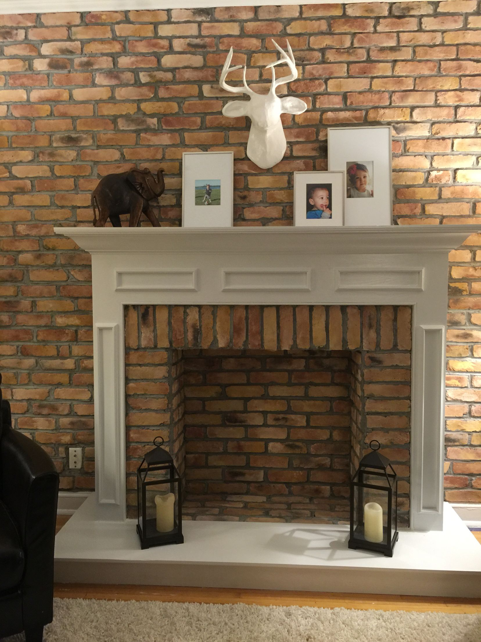faux fireplace mantle and hearth built with 2x4s and plywood