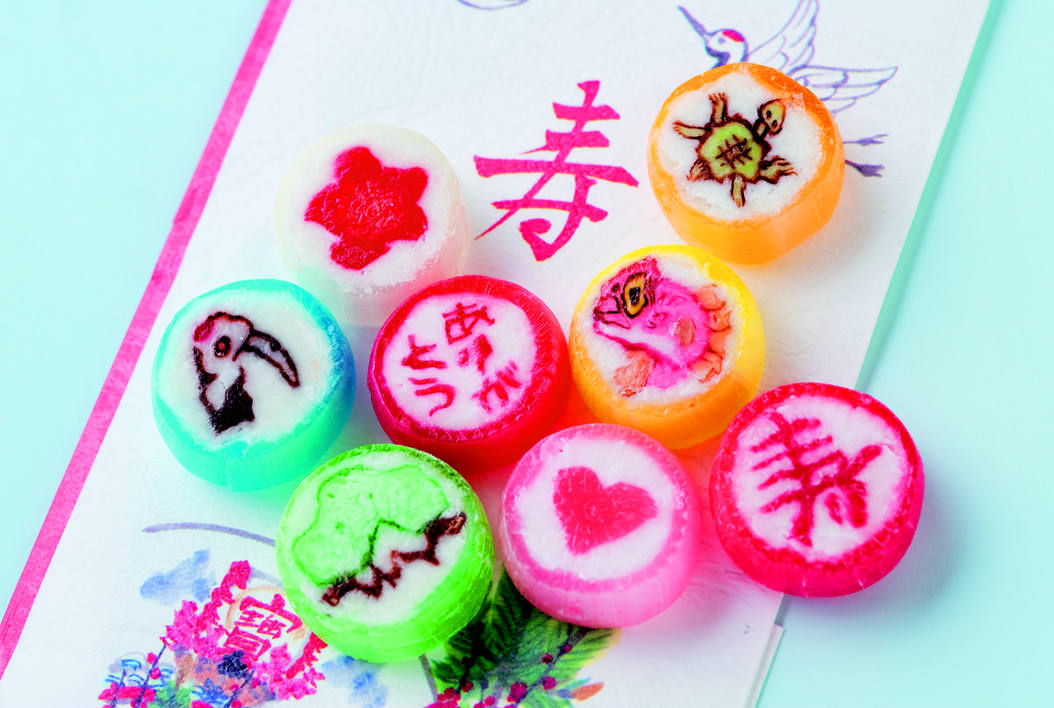 """This candies familiar as """"Kintaro Ame"""" with Japanese people. In case of wedding gift, brides and grooms can insert illust of their faces to candies. They can also choose blissful ones in several options. We will recommend to send this candies for intimate people in not only special situation but also daily life. ©Kintaroame honten http://www.kintarou.co.jp/"""