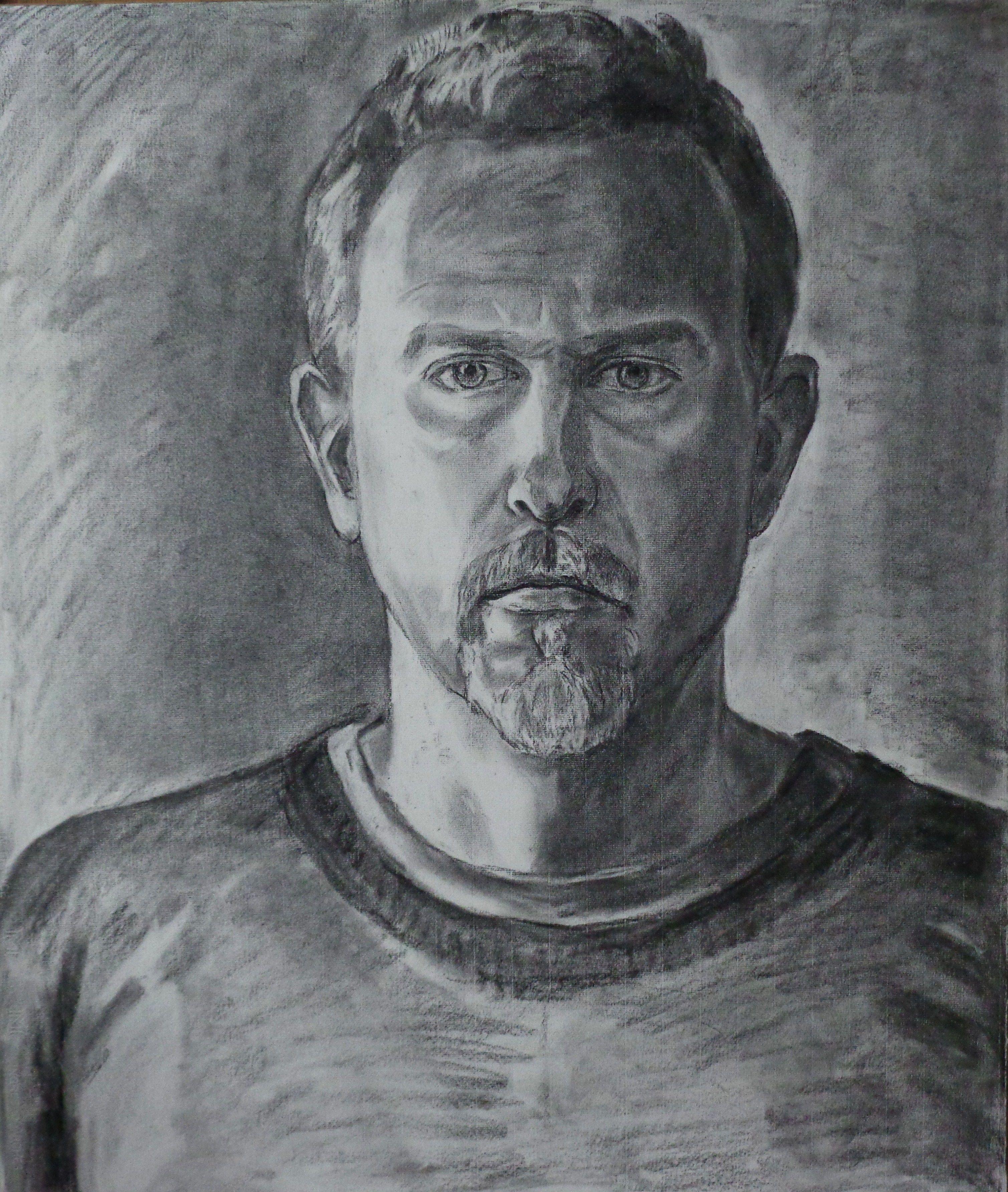 Charcoal drawing of a man by oscar estevez