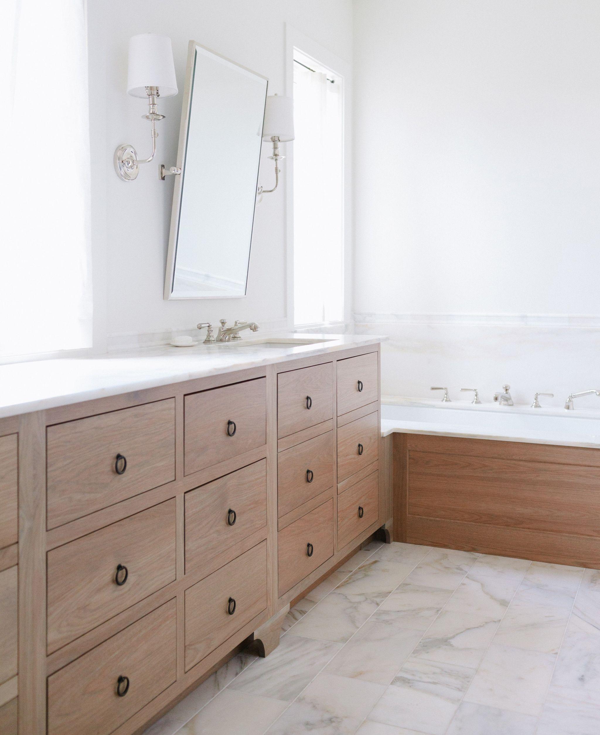 Light wash wooden drawer vanity in master bathroom jean - Small bathroom vanity with drawers ...