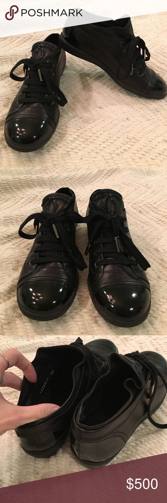 CHANEL black leather sneakers CHANEL sneakers. Patent leather toe and heel accents. CHANEL logo on tongue of shoe above where you would tie the laces. Metal CHANEL accents on ends of laces. Never worn out. In brand new condition. Size 37. Made in Italy. Open to offers! CHANEL Shoes Sneakers