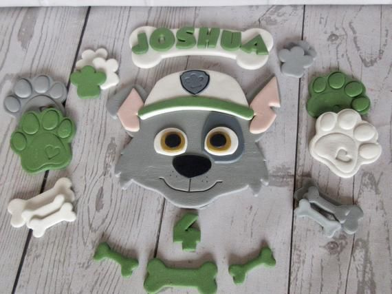 Rocky Paw Patrol Cake Topper  Edible Paw Patrol Rocky Fondant Rocky paw patrol  Personalised paw pat - Paw patrol cake, Paw patrol cake toppers, Paw patrol, Paw, Cake toppers, Topper -  vegetarian Dairy freeMade in an environment that handles nuts  (May contain traces )STORAGEStore in a cardboard lidded box away from direct sunlight  Do not refrigerate or freeze  Do not store cakes in an airtight container or this will cause the items to wilt Good for six months from date of purchase SHIPPINGPlease order in plenty of time for your occasion  I post in the UK via Royal Mail (23 days usually )Europe 35 business days standard Rest of the world 67 business days standard  (In my experience deliveries can take longer than the estimated shipping dates given by the couriers  Buyers are responsible for any customs and import taxes that may apply, I am not responsible for customs delays FEEDBACKAll items are made and packaged with great care to ensure safe delivery  If you are not happy with your order please do not hesitate to contact me  I would like the opportunity to resolve any issues before negative feedback is given