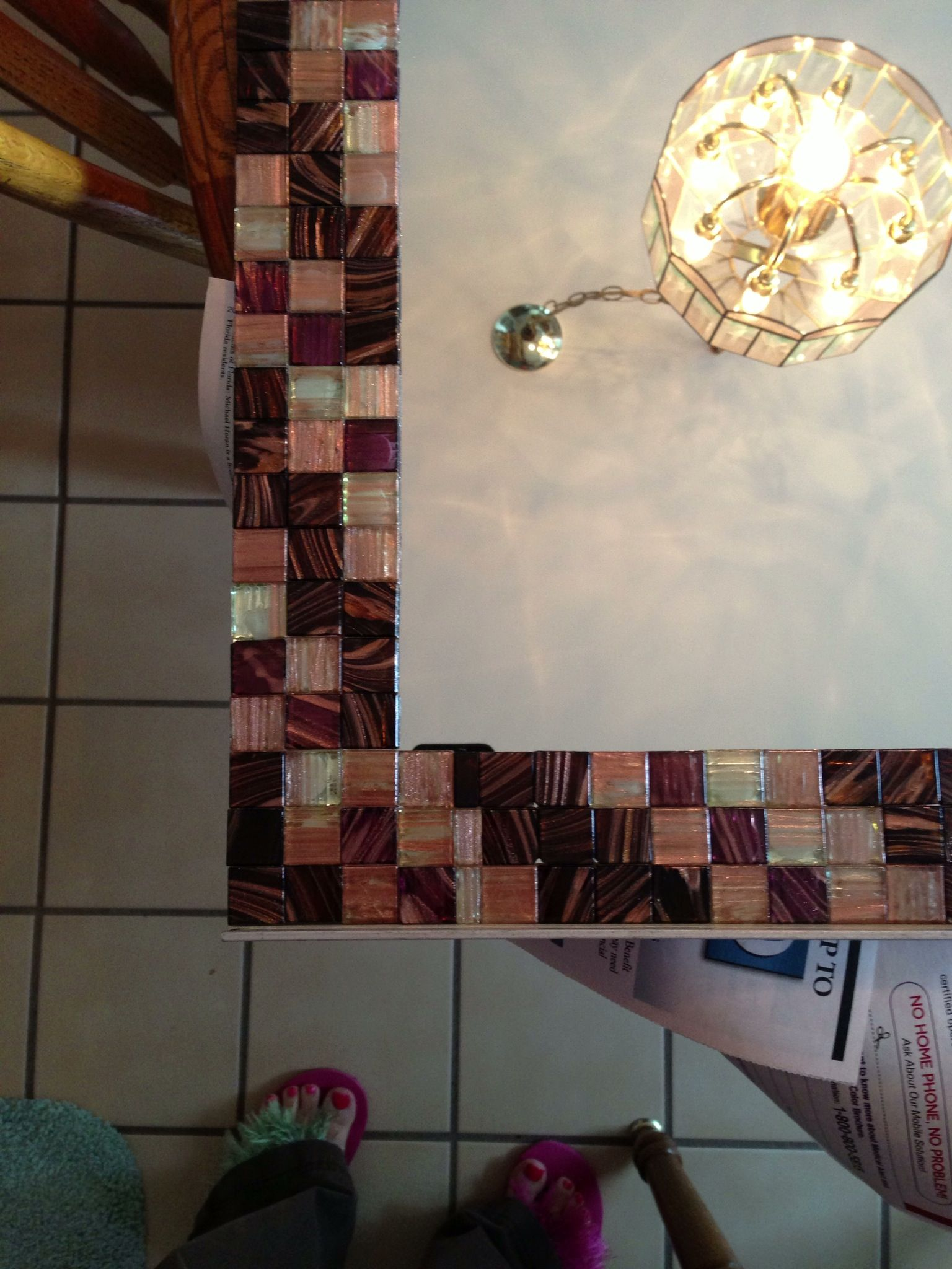 Closeup of the bathroom mirror tiles were glued down