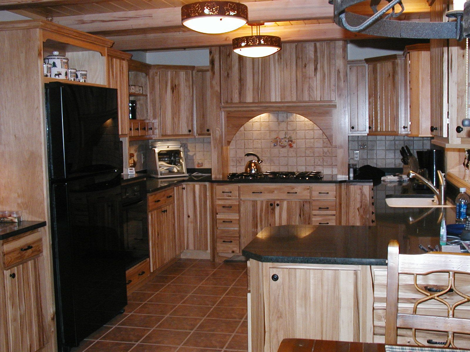 A north woods home with a galley style kitchen. The cabinets are ...