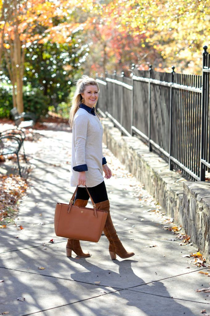 A cute winter outfit with over the knee boots and a beige sweater.