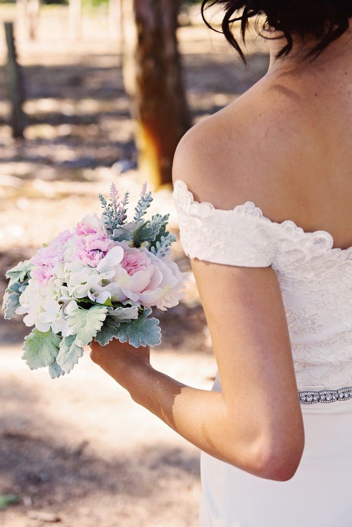 A beautiful bride wears an off shoulder wedding gown for a Mint colour themed wedding