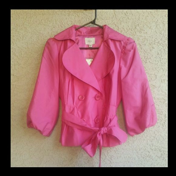 Pink Cropped Trench Coat/Jacket Stylish cropped jacket by ECI. This jacket is so cute!  You could  Dress it up or down, wear it with jeans or over a formal dress. So unique and versatile!   Fully lined with pink satin like fabric, double breasted buttons, with a tie at the waist. Puffy 3/4 length sleeves.  *Size 2 *New with tags! ECI Jackets & Coats Trench Coats