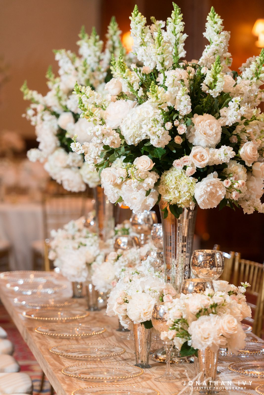 Large floral arrangements of white stock peonies and