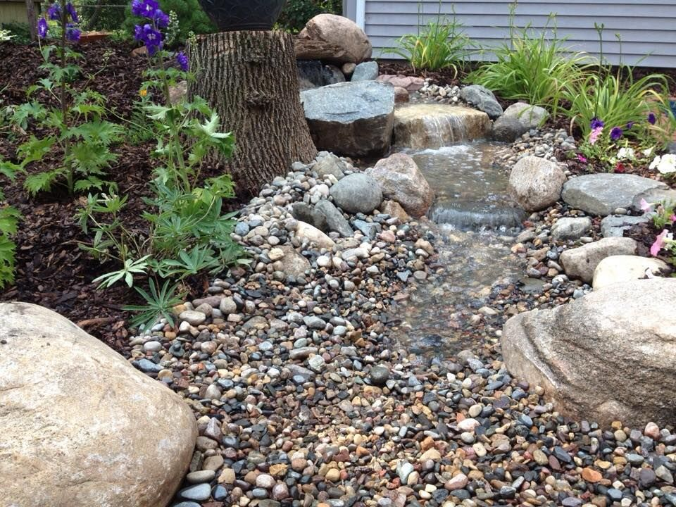 Waterfall created by Inspired Design Landscapes Inc. in Columbia Heights, MN. #WaterfallWednesday
