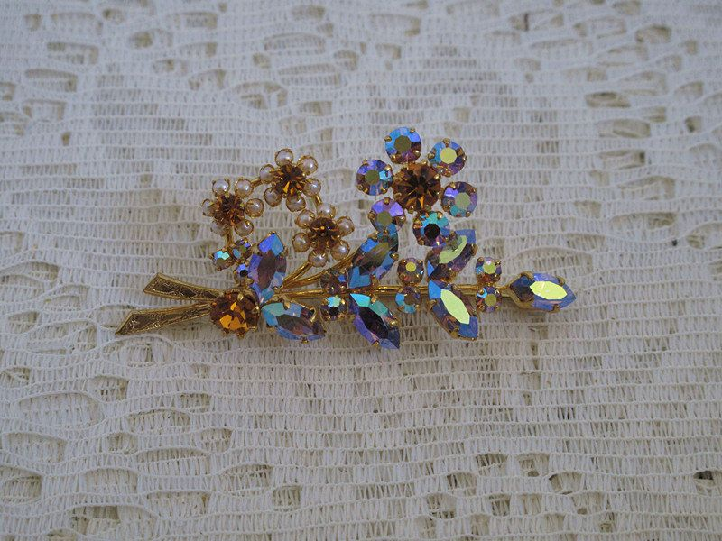 Floral brooch, gold plated, rhinestone brooch. £12.00, via Etsy.