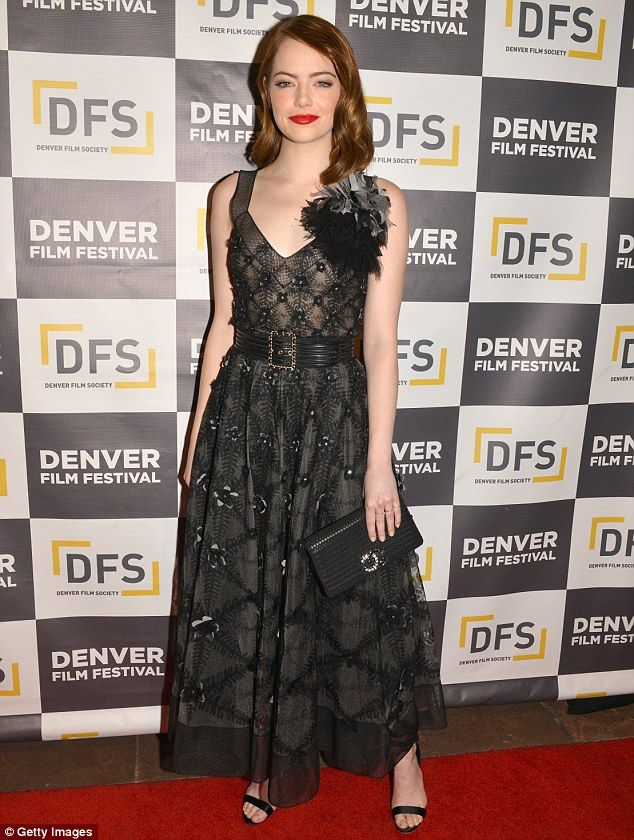Stylish display: Emma Stone looked typically glamorous in a sweeping Chanel dress during a...