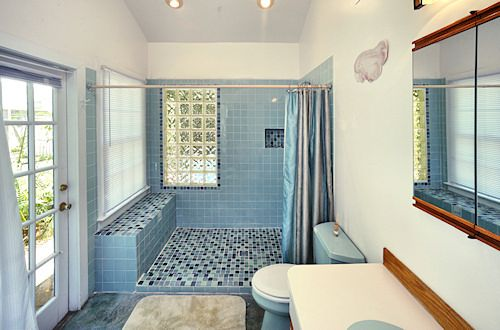 Tropical Bathroom Has Exterior Door That Leads To The Swimming