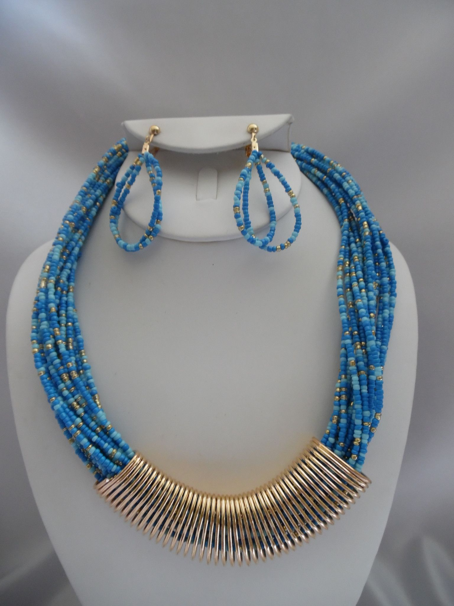 Visit: hipandcoolcliponearringstwo.com and receive up to 30% off. CLIP ON EARRINGS BLUE & GOLD MULTI COLORED SEED BEAD NECKLACE SET  $15.99 http://hipandcoolcliponearringstwo.com