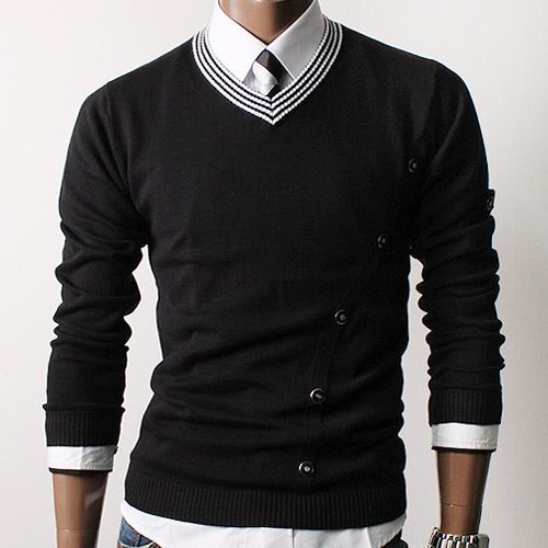 Black sweater, striped collar, and matching tie.