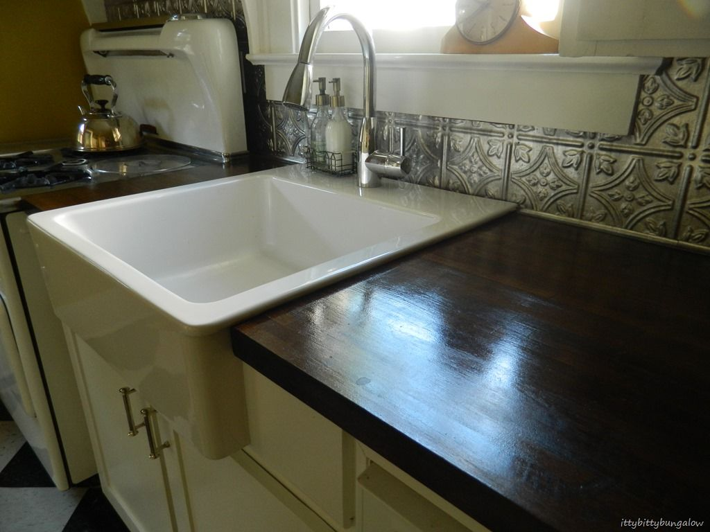 Appealing Ikea Farmhouse Sink For Your Kitchen Design Dark Wood Countertop With Ikea Farmhouse Sink And Tin Backsplash For Modern Kitchen Design