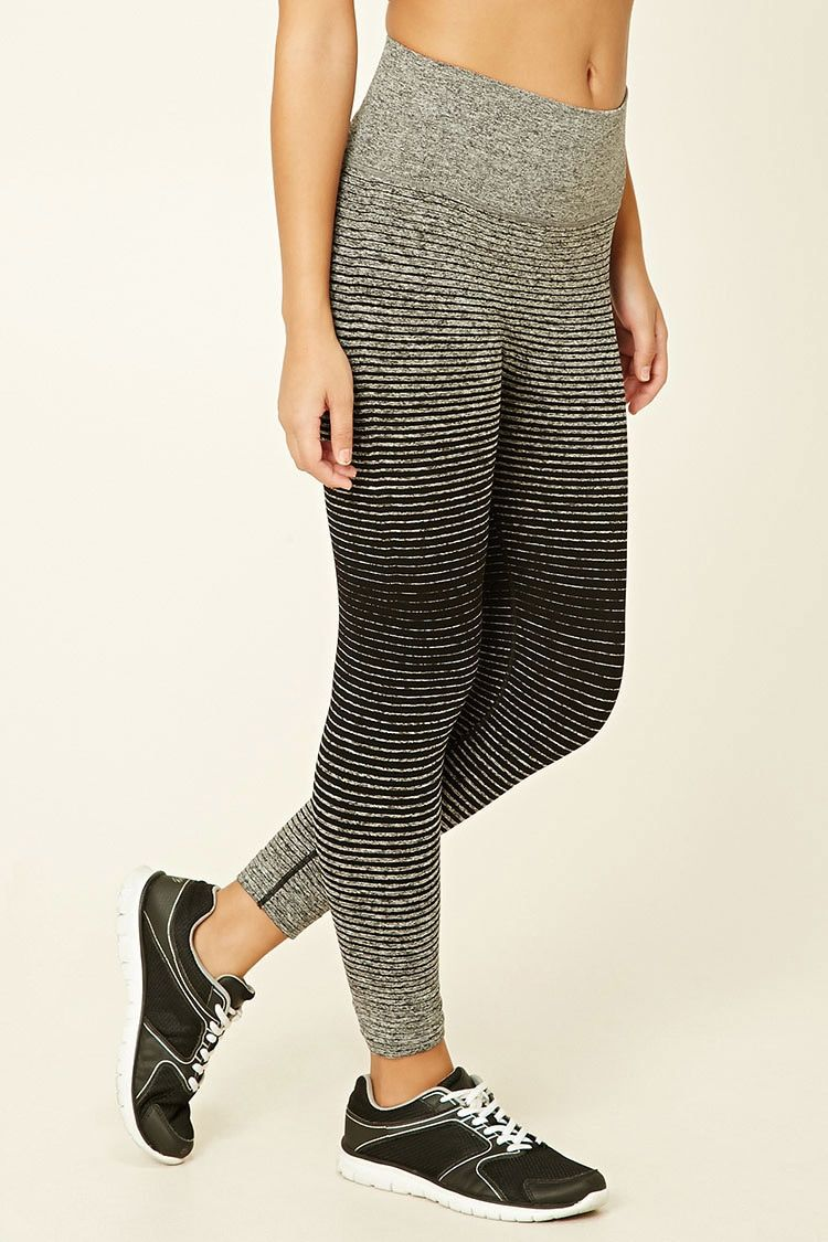 A pair of knit capri leggings featuring a striped gradient pattern, a seamless design, and moisture management.