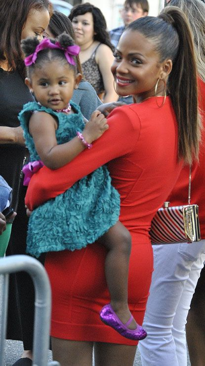 Christina Milian with her cute little daughter Violet Madison Nash at the Disney Pixar's 'Brave' World Premiere at Dolby Theater in Hollywood on June 19, 2012.