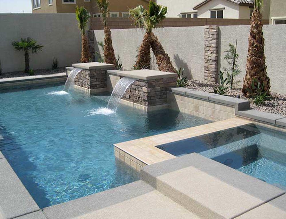 Custom Small Rectangular Pool With Raised Spa Tanning Ledge Loungers And Umbrella Artistic Pool A Small Backyard Pools Pools Backyard Inground Geometric Pool