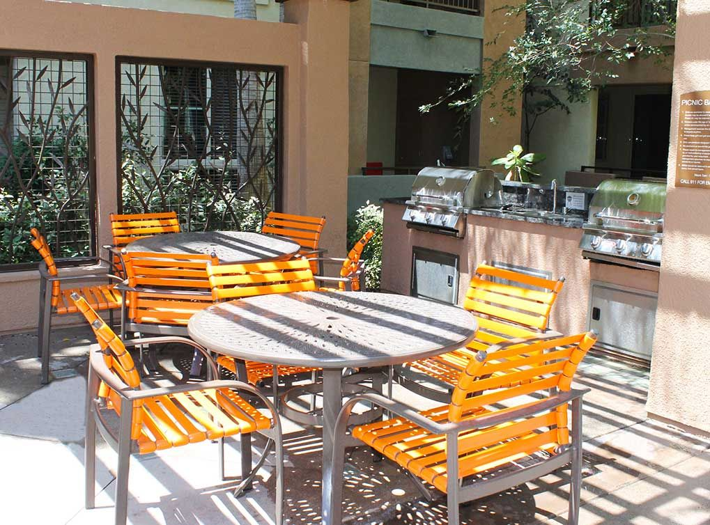 Outdoor Grill Area At Amli Warner Center Luxury Apartments In San Fernando Valley