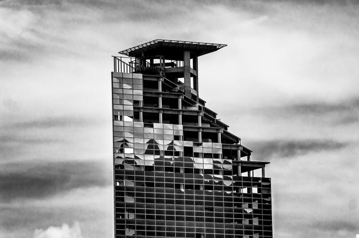 Venezuela, the Tower of David - a half-built skyscraper inhabited by lots of people with nowhere to go. A great example of poeple's... resourcefulness outside the law. Sadly, as of 2014, the government started relocating its inhabitants. Hopefully to a better place.