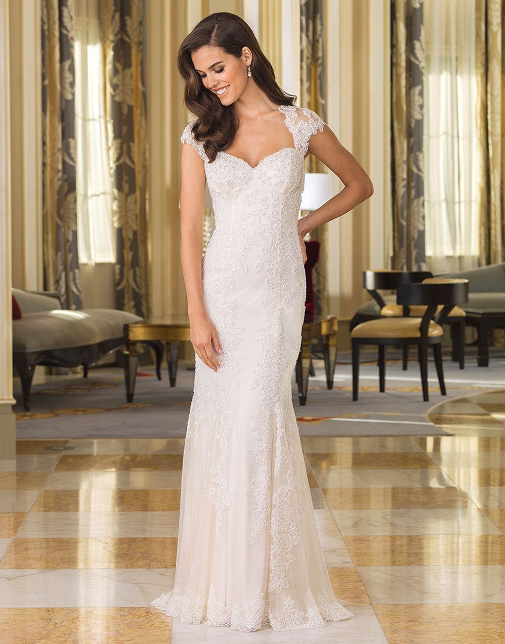 The pearl and metallic beading throughout this straight jersey gown ...