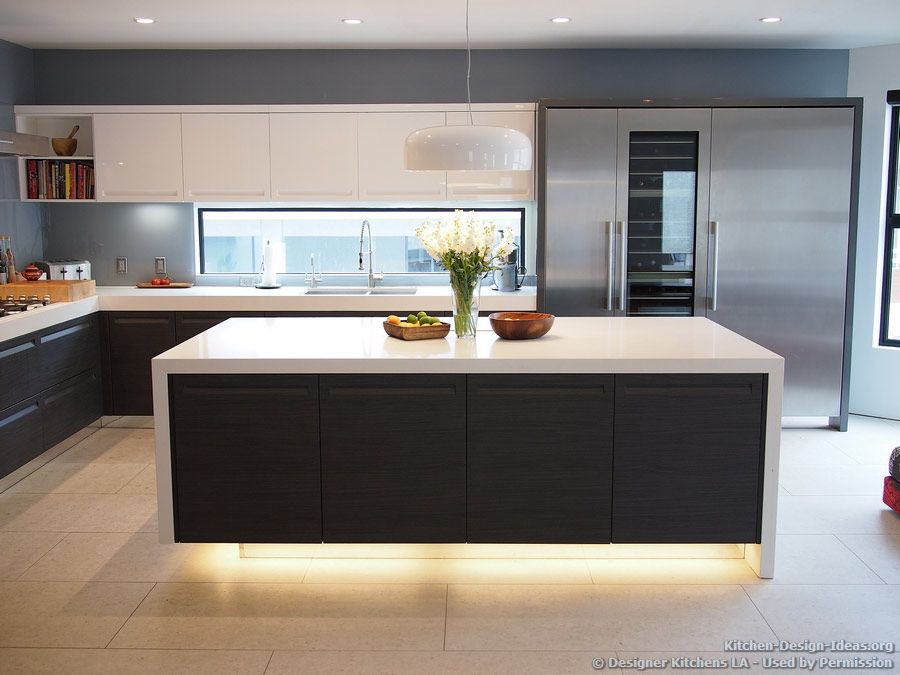 Modern Kitchen With Luxury Appliances Black White Cabinets Island Lighting And A Backsplash Window Kitchen Design Ideas