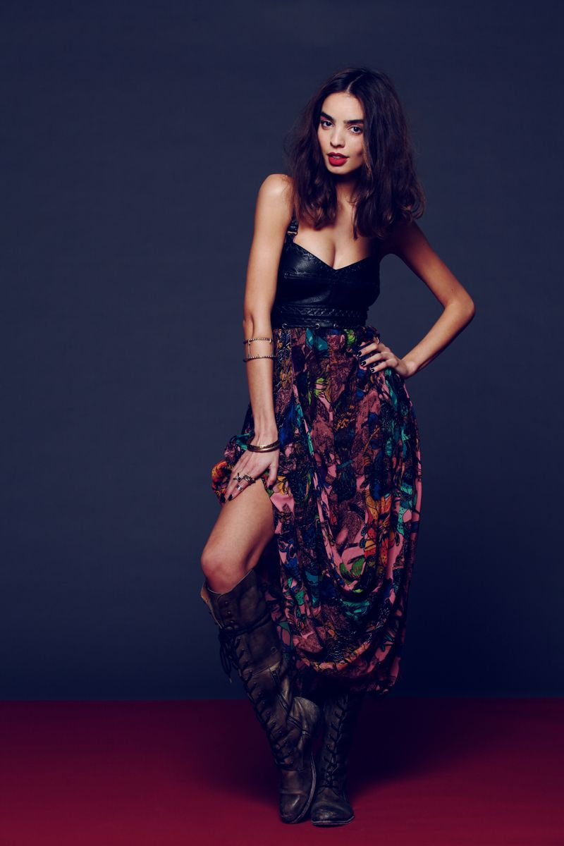 Sexy, dark boho look. Edginess of the leather bustier & boots is tamed by the vibrant maxi.