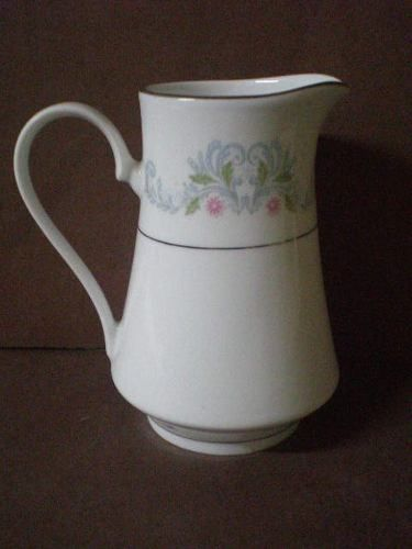 antigua lechera de porcelana sellada