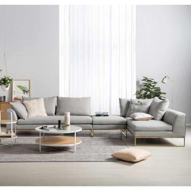 Asymmetry L Shaped Couch Is Balanced Out By The Round