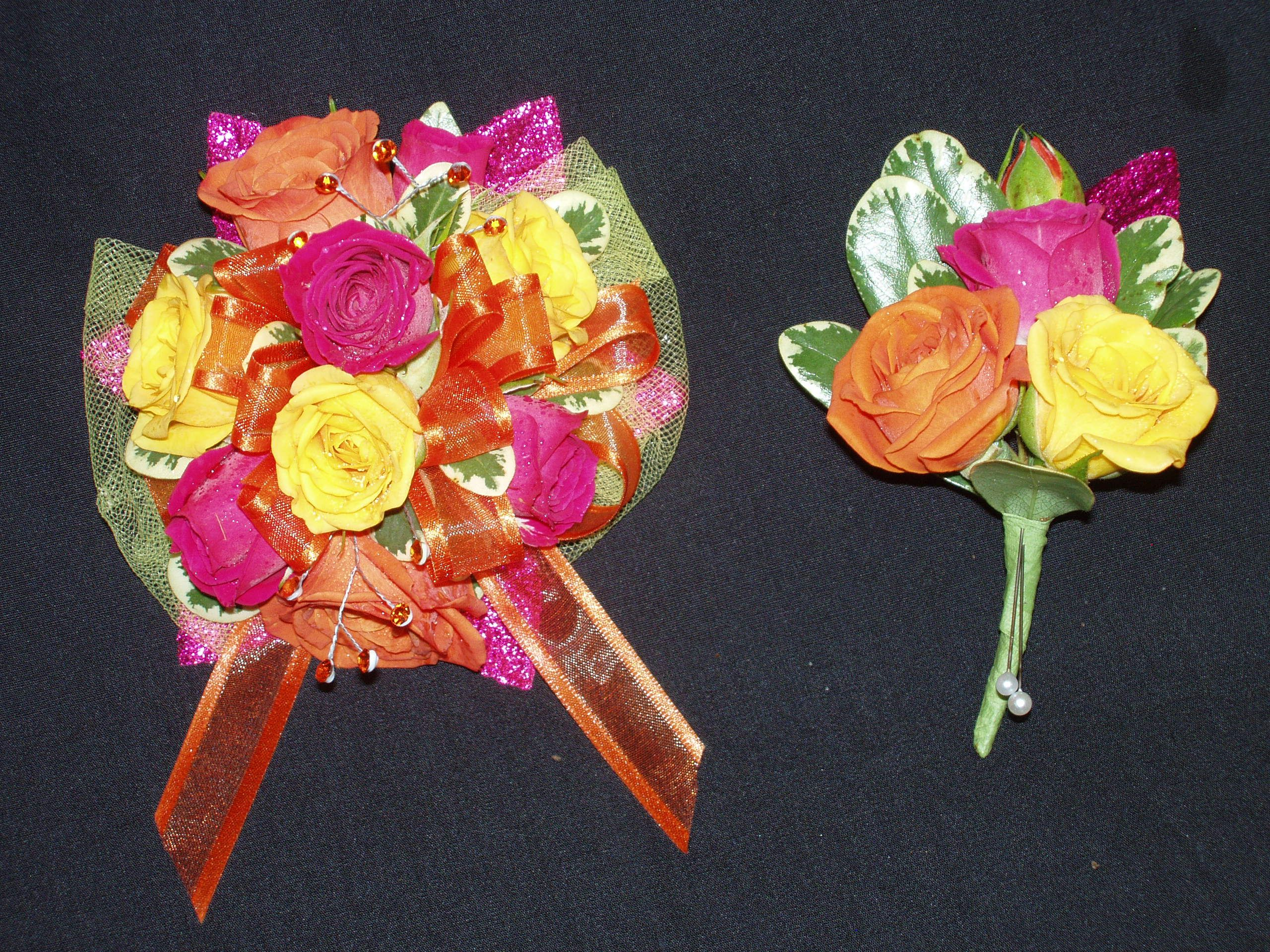 Wrist Corsage Hot Pink Yellow And Orange Spray Roses And A