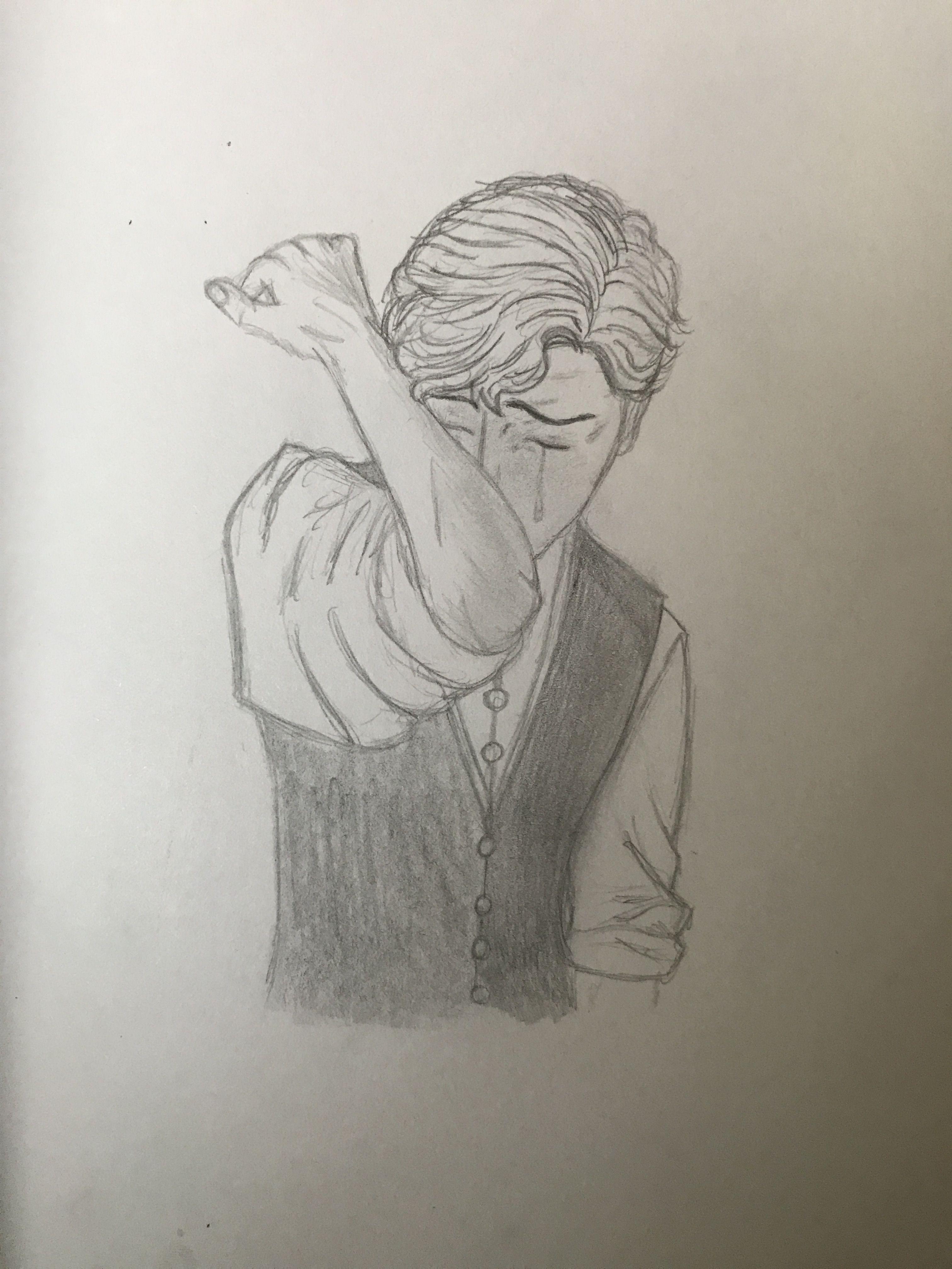 Crying man drawing