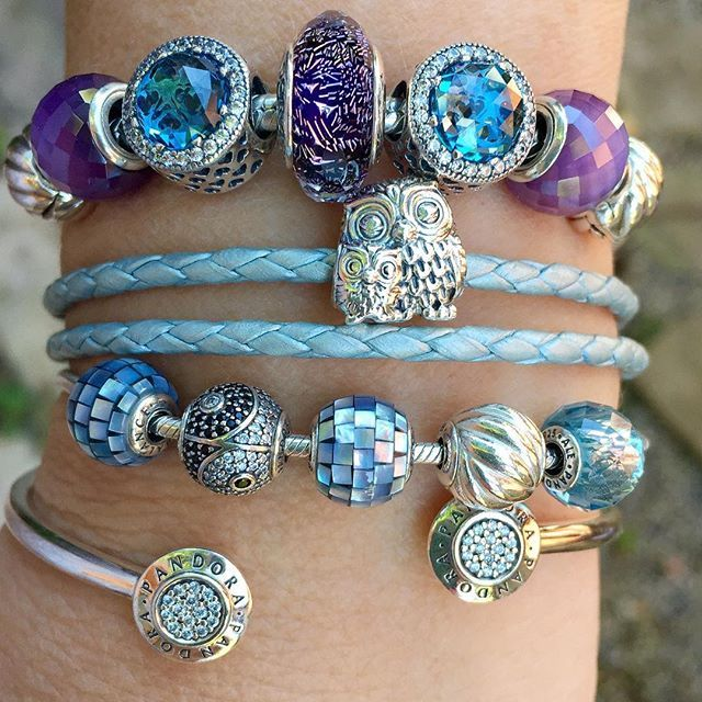 Radiant Hearts Sky Blue crystals look like owl eyes, so I just had to include the Charming Owls in this stack. #theofficialpandora #officialpandora #myarmparty #uniqueasyouare #owls #crystals #blue #skyblue #motherofpearl #mosaic #essence #balance #health #friendship #signaturebangle #silverbracelets #pandorabracelets #pandoraaddict @theofficialpandora