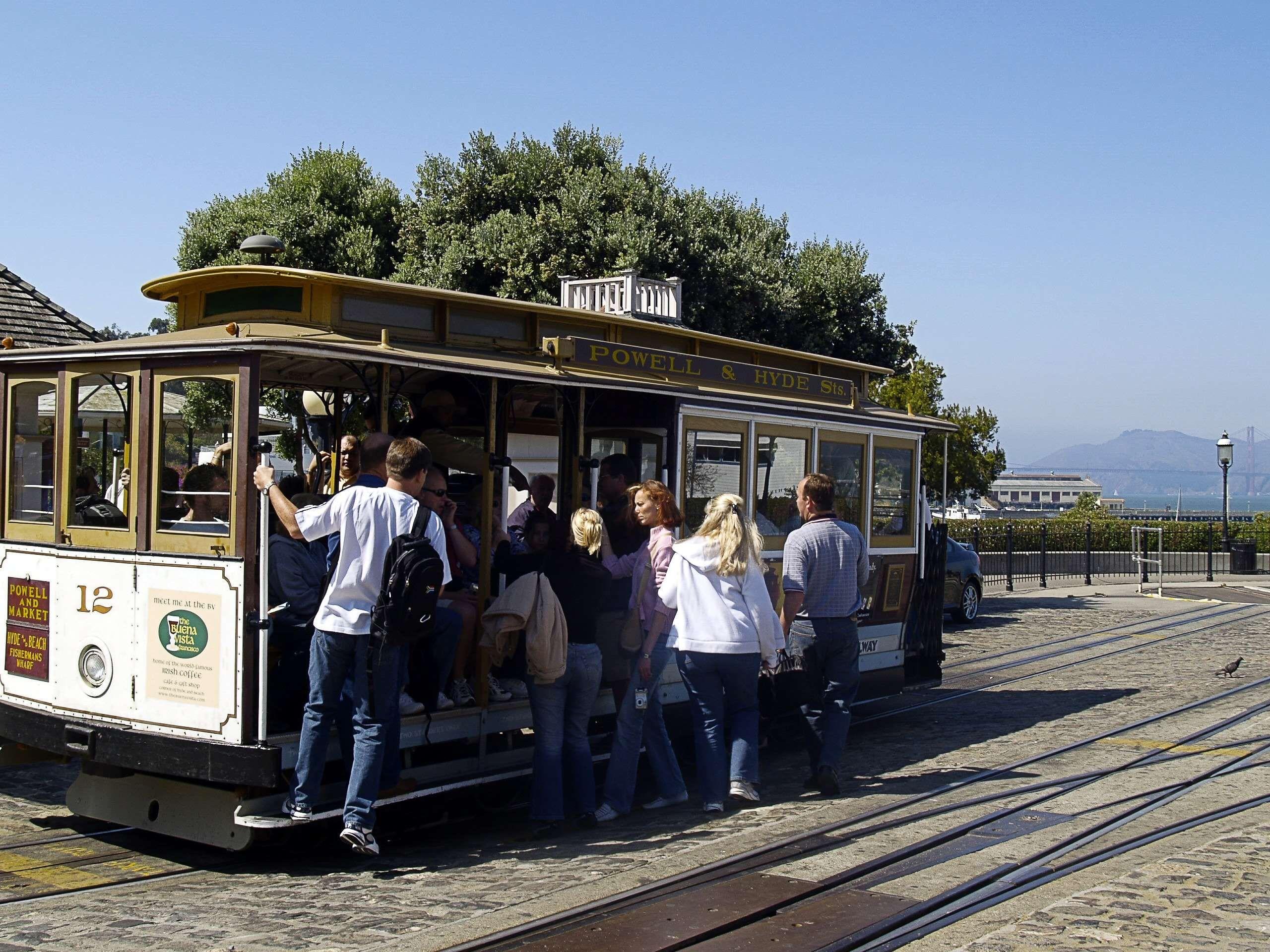 cable car california city crowd san francisco tourist