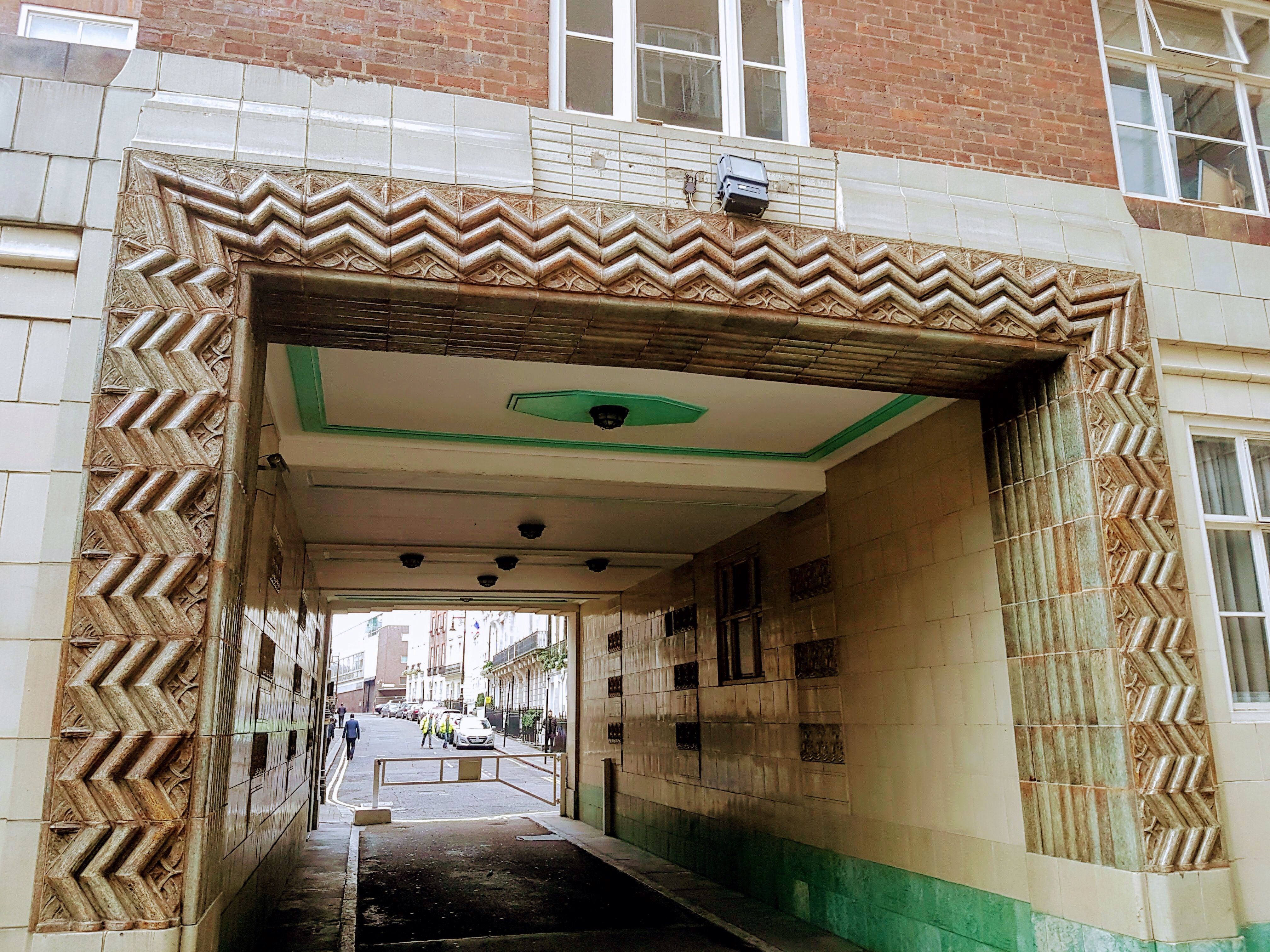 Art Deco detail at Carrington House, Hertford Street in Mayfair, London. This is a residential block of flats and although some of the original features are no more, there are some lovely survivors, such as this through way from the street to the (quite small) residents car park.
