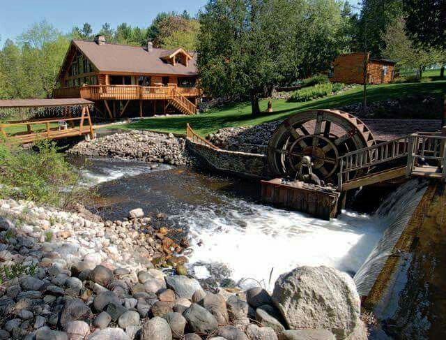 Cabin and a creak with a water wheel