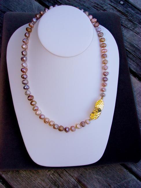 Metallic pearls with 18 karat hand-hammered clasp. Earthdream Studio