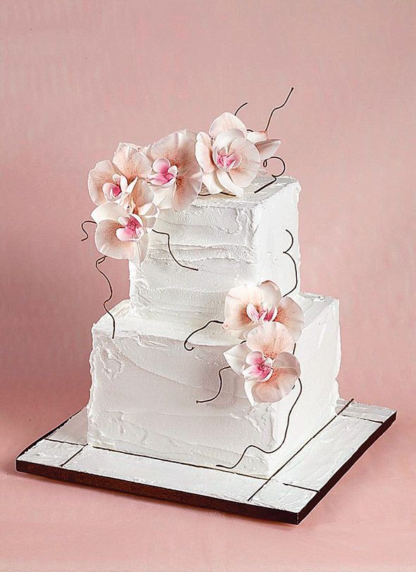 White Buttercream Wedding Cake with Pale Pink Florals & Twig Accents