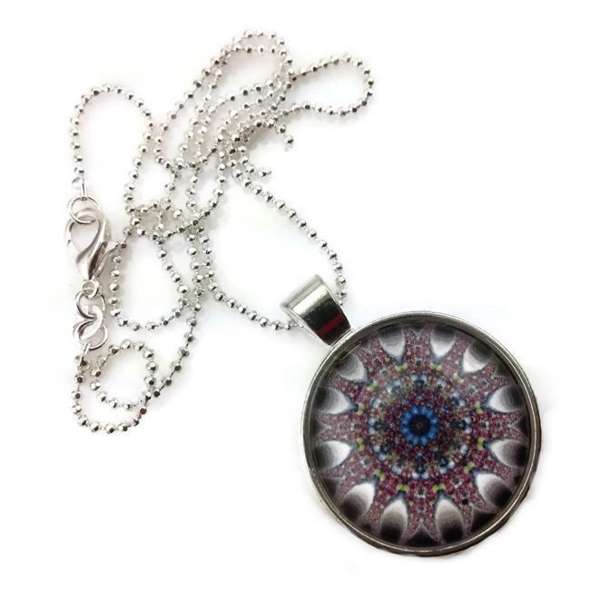 A beautiful handmade glass dome pendant style necklace, with a beautiful purple sophisticated kaleidoscope like design, available with a Sterling silver or leather style necklace.