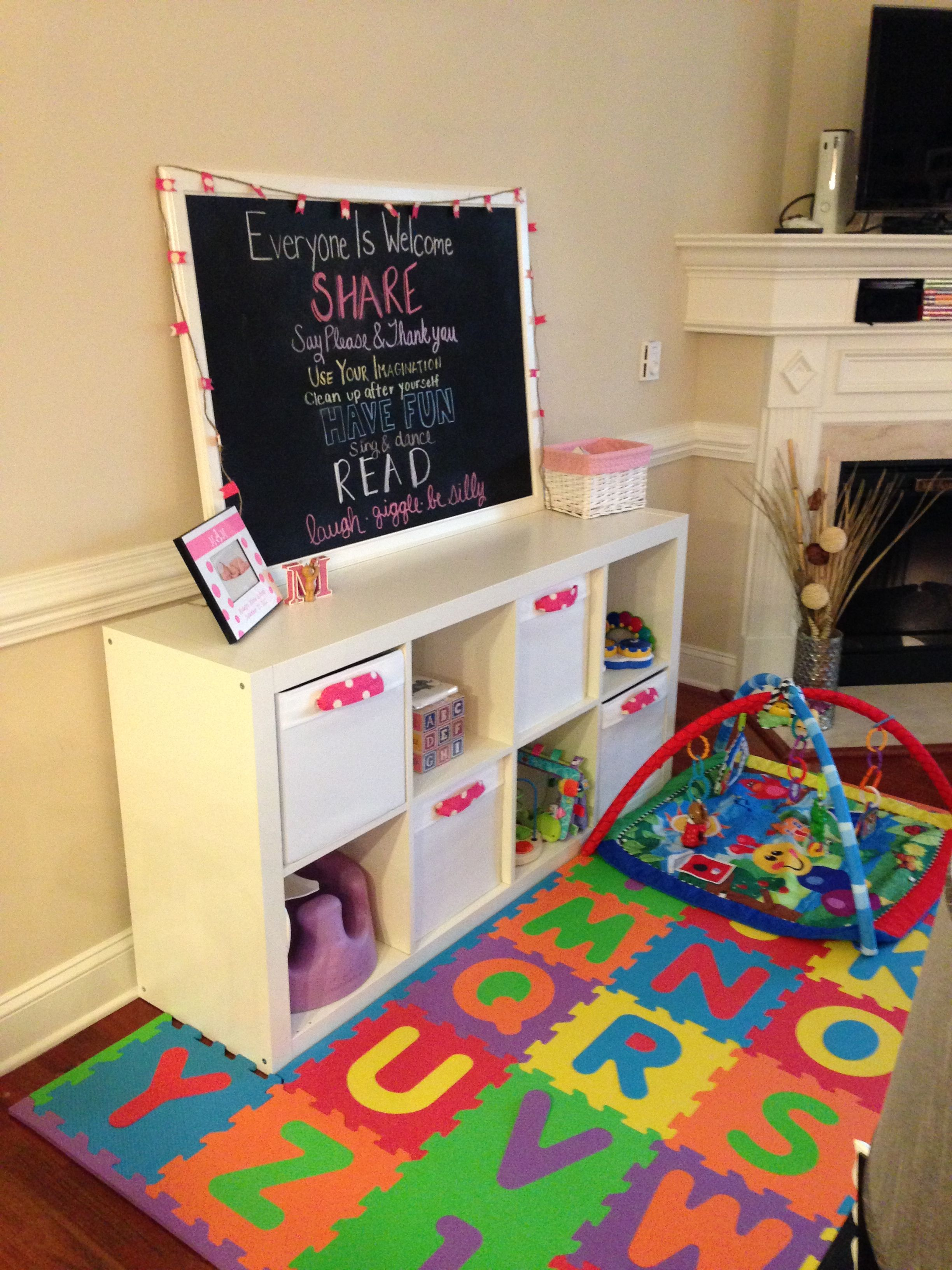 Playroom in our small condo living room baby girl for Kids play area in living room ideas