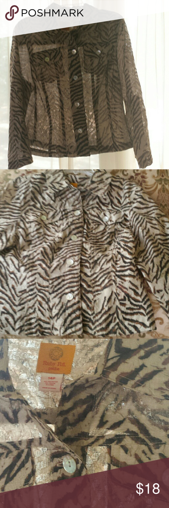 Ruby Rd Animal Print Sheer Blouse. Size 14P Very nice sheer button down blouse in animal print by Ruby Rd. In excellent used condition. No holes, stains, or flaws. Sleeves can be rolled and buttoned to make them 3/4 length.  So cute with a black or tan cami under it, worn with jeans or slacks and boots, or a skirt and heels. Great for work and play. Size 14 Petite. Ruby Rd Tops Blouses