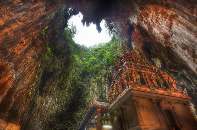 Batu Cave, Malaysia The limestone forming the Batu Cave is dated back 400 million years, and evidence of human use of the cave can be dated to indigenous tribes. Batu Cave has since been dedicated as a Hindu religious site, attracting worshippers and tourists from all over the world to observe the peaceful and ornate temples, shrines, and statues that have been erected inside the cave and in surrounding areas.