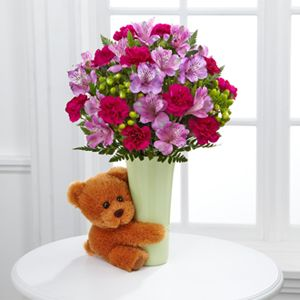 Big Hug arrangement! Come with flowers and a stuffed bear for baby. Just add water daily! H&J Florist & Greenhouses of St Joseph, MI 269-429-3621 love the idea of new babies, and what better way to spoil the parents than to send pretty flowers! Let them know you are thinking of them, it wont last forever! *Wink Wink*