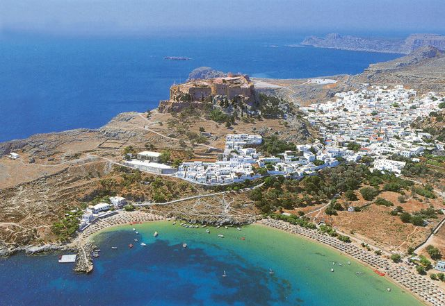 the Acropolis of Lindos, Rhodes (seen on top of the hill while all around the hill there are the ruins of the ancient city of Lindos), Greece