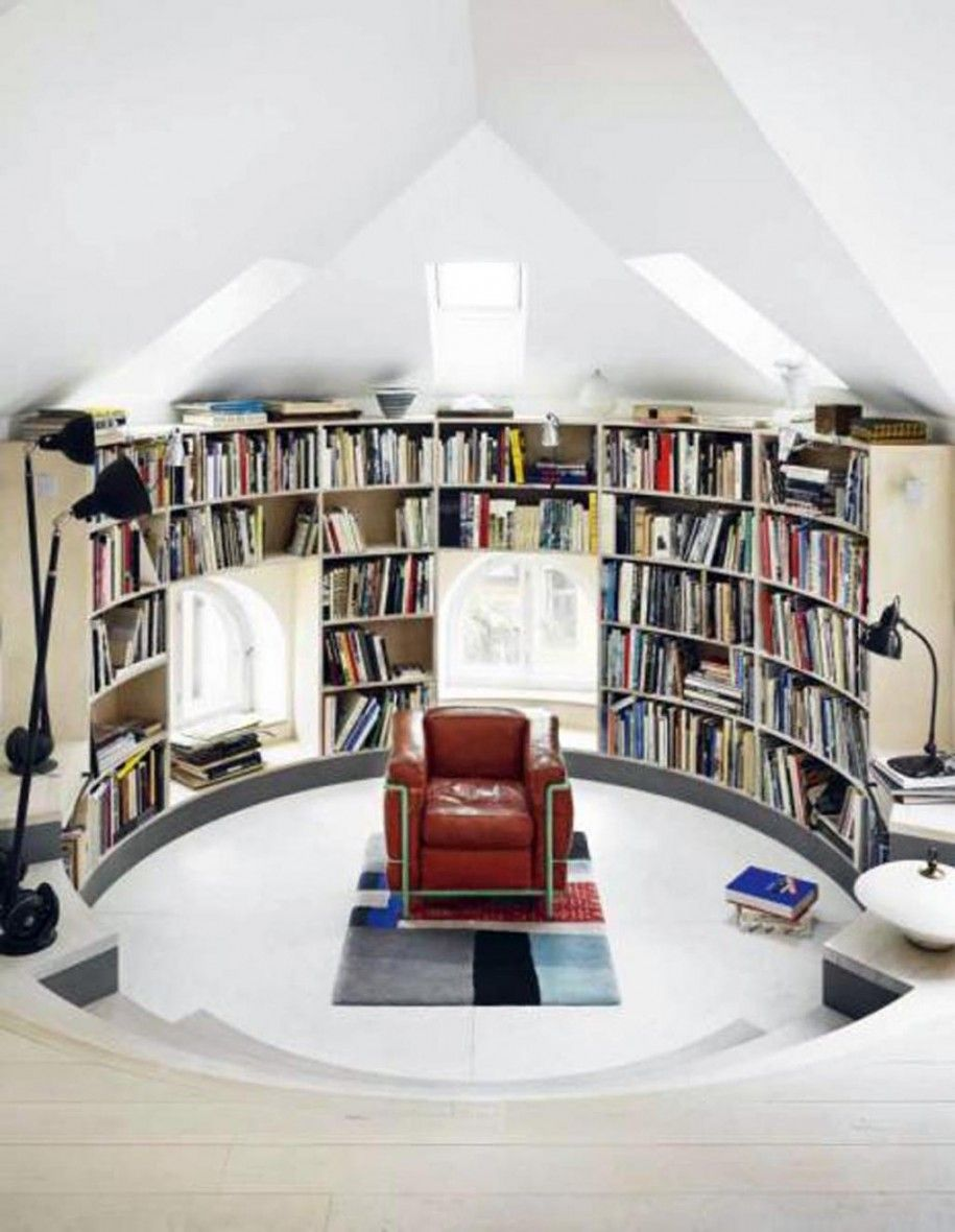Round Home Library - Mine will be larger, on the main floor. The sunken area will hold my grand piano. There will be a seating area in the raised part of the room, and space for other instruments. There will be shelves of books, from floor to ceiling, all around the edges of the round part of the room, interspersed with large, tall, windows with window seats. Above the library/music room will be the office/media room.